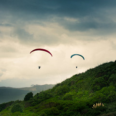 two parasailers in the sky